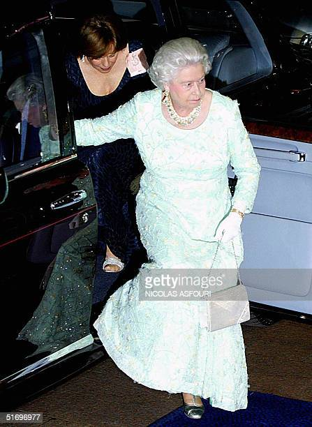 """Britain's Queen Elizabeth II arrives for the premiere of """"Ladies in Lavender"""" at the Odeon cinema in Leicester square, West London 08 November 2004...."""