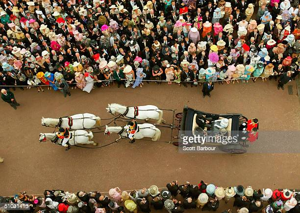 Britain's Queen Elizabeth II arrives in her horse drawn carriage to attend Ladies Day on the third day of Royal Ascot at the Ascot Racecourse on June...