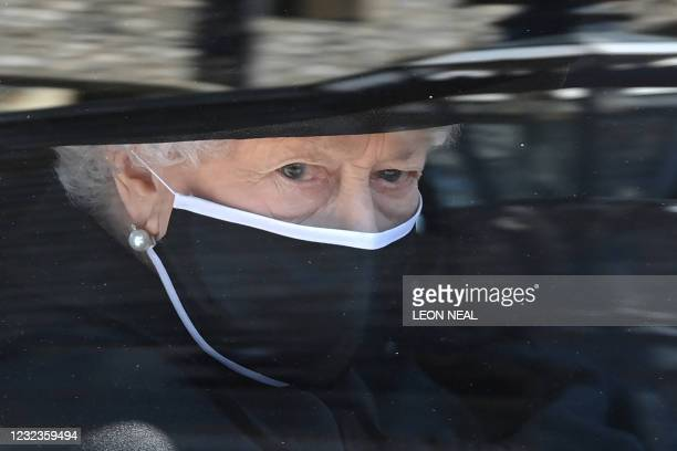 Britain's Queen Elizabeth II arrives in the Royal Bentley at the funeral for her husband, Britain's Prince Philip, Duke of Edinburgh to St George's...