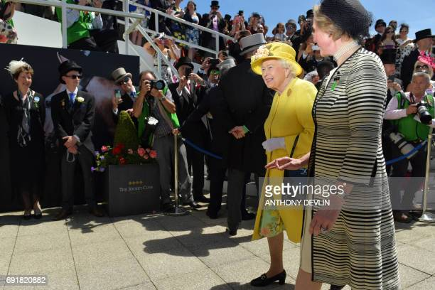 Britain's Queen Elizabeth II arrives on the second day of the Epsom Derby Festival in Surrey southern England on June 3 2017 / AFP PHOTO / Anthony...