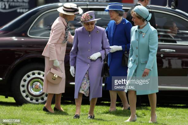 Britain's Queen Elizabeth II arrives on the second day of the Epsom Derby Festival in Surrey, southern England on June 2, 2018.