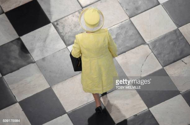 Britain's Queen Elizabeth II arrives to attend a national service of thanksgiving for the Queen's 90th birthday at St Paul's Cathedral in London on...