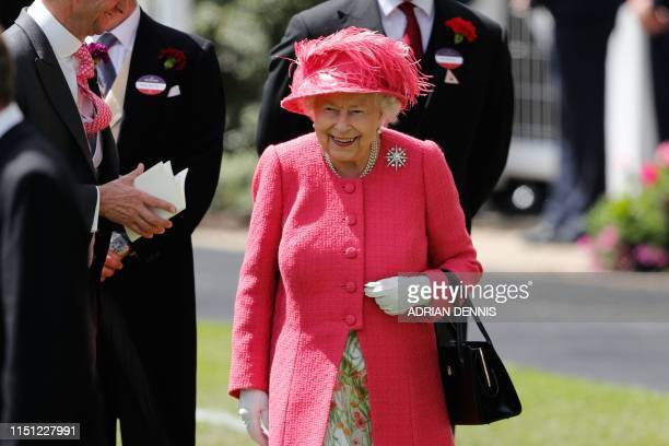 Britain's Queen Elizabeth II arrives to attend day four of the Royal Ascot horse racing meet, in Ascot, west of London, on June 21, 2019. - The...