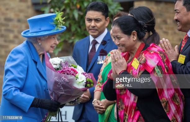 Britain's Queen Elizabeth II arrives to visit the Haig Housing Trust in Morden southwest London on October 11 to open their new veteran housing...