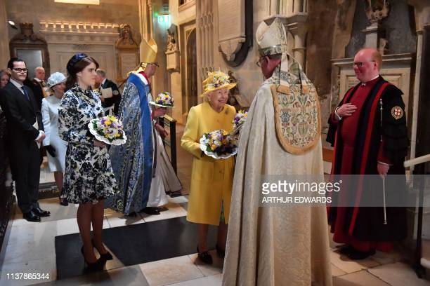 Britain's Queen Elizabeth II arrives with Britain's Princess Eugenie of York to take part in the Royal Maundy Service at St George's Chapel in...