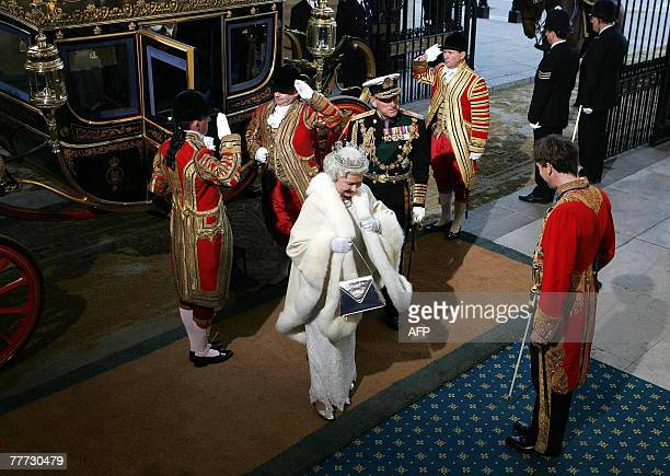 Britain's Queen Elizabeth II arrives with the Duke of Edinburgh at the Soverign Entrance of the House of Lords, in Westminster, in London, 06...