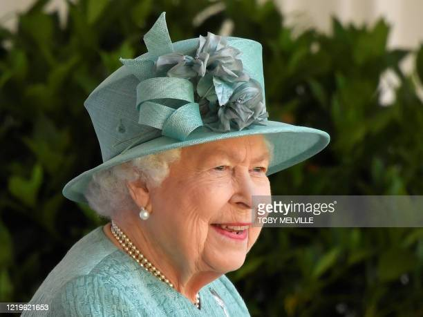 Britain's Queen Elizabeth II attends a ceremony to mark her official birthday at Windsor Castle in Windsor, southeast England on June 13 as Britain's...