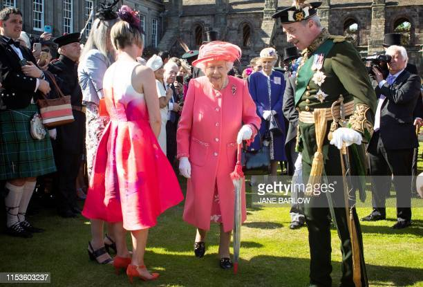 Britain's Queen Elizabeth II attends a garden party at the Palace of Holyroodhouse in Edinburgh on July 3, 2019.