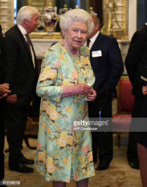 Britain's Queen Elizabeth II attends a reception for the winners of The Queen's Awards for Enterprise 2017 at Buckingham Palace in central London on...