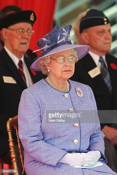 Britain's Queen Elizabeth II attends commemoration ceremonies for Canadian DDay veterans at Juno Beach June 6 2004 in Normandy France