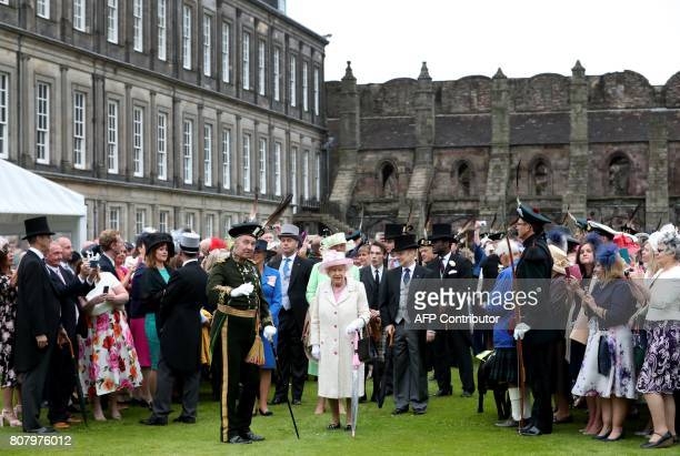 Britain's Queen Elizabeth II attends the annual garden party at the Palace of Holyroodhouse in Edinburgh on July 4 2017 / AFP PHOTO / POOL / Jane...