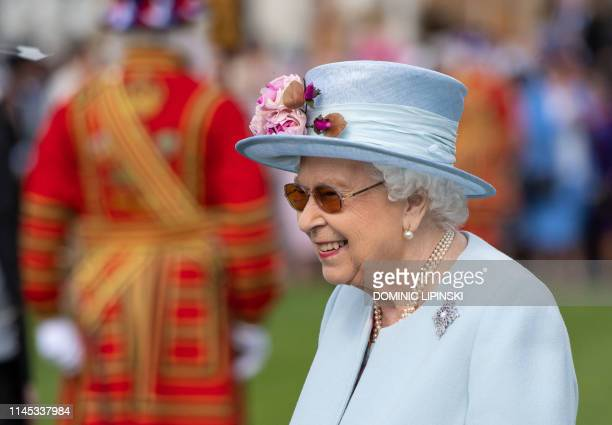 Britain's Queen Elizabeth II attends the Garden Party at Buckingham Palace in central London on May 21 2019