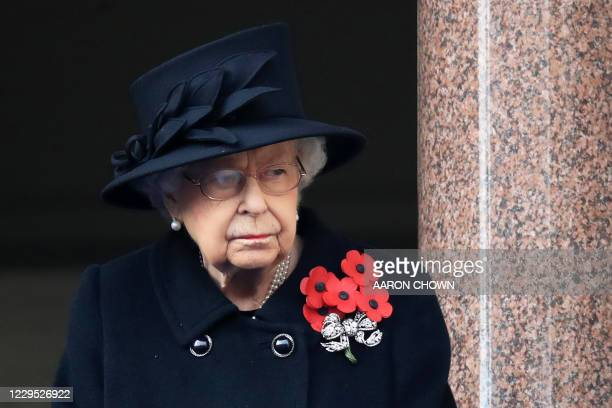 Britain's Queen Elizabeth II attends the Remembrance Sunday ceremony at the Cenotaph on Whitehall in central London, on November 8, 2020. -...