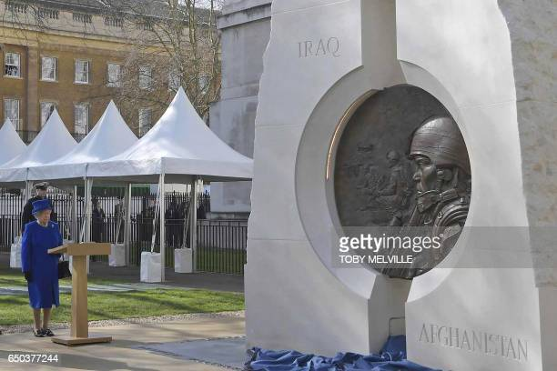 Britain's Queen Elizabeth II attends the unveiling of The Iraq and Afghanistan memorial at Victoria Embankment Gardens in central London on March 9...