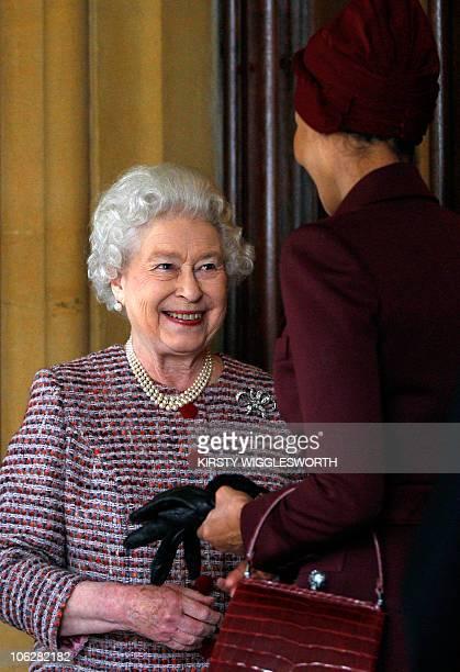 Britain's Queen Elizabeth II bids farewell to Sheikha Mozah and her husband Qatar's emir Sheikh Hamad bin Khalifa alThani on the final day of their...