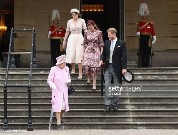 Britain's Queen Elizabeth II Britain's Prince Harry Duke of Sussex Britain's Princess Eugenie of York and Britain's Princess Beatrice of York arrive...