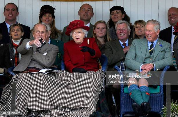 Britain's Queen Elizabeth II Britain's Prince Philip Duke of Edinburgh and Britain's Prince Charles Prince of Wales attend the annual Braemar...