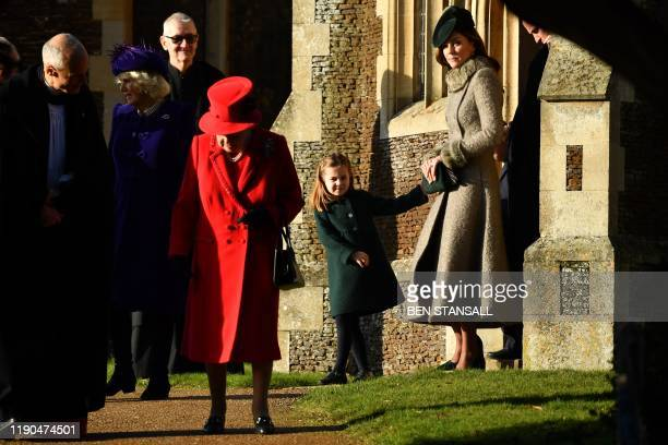 Britain's Queen Elizabeth II, Britain's Princess Charlotte of Cambridge and Britain's Catherine, Duchess of Cambridge leave after the Royal Family's...