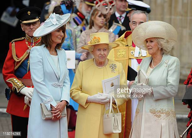 Britain's Queen Elizabeth II Carole Middleton and Camilla Duchess of Cornwall come out of Westminster Abbey in London following the wedding ceremony...
