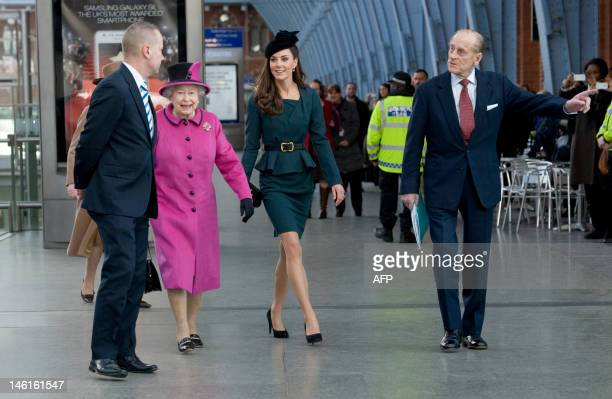 Britain's Queen Elizabeth II Catherine Duchess of Cambridge and Prince Philip Duke of Edinburgh arrive at Kings Cross St Pancras Station London...
