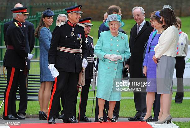 Britain's Queen Elizabeth II Catherine Duchess of Cambridge and Prince William visit Vernon Park in Nottingham central England on June 13 2012 The...