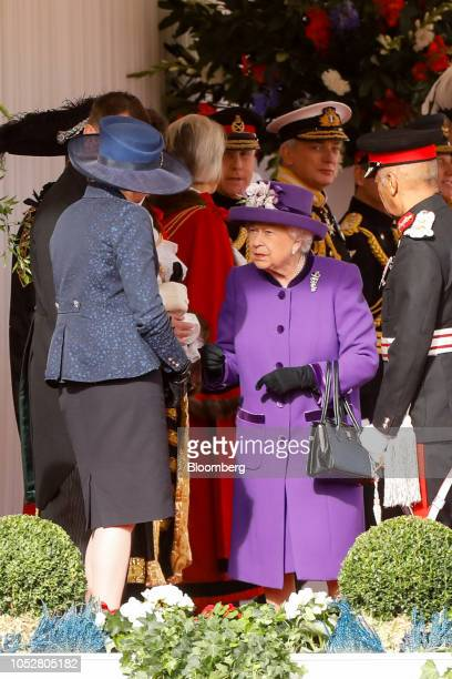 Britain's Queen Elizabeth II center speaks with Theresa May UK prime minister left at a ceremonial arrival event to welcome Dutch...