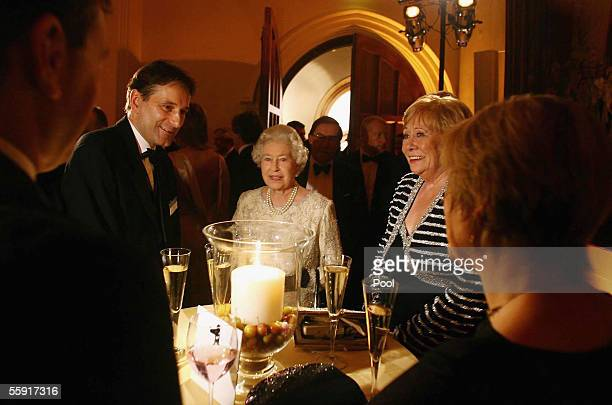 DAYS Britain's Queen Elizabeth II chats to guests at the ITV 50th Anniversary celebration including Liz Dawn who plays Vera Duckworth in Coronation...