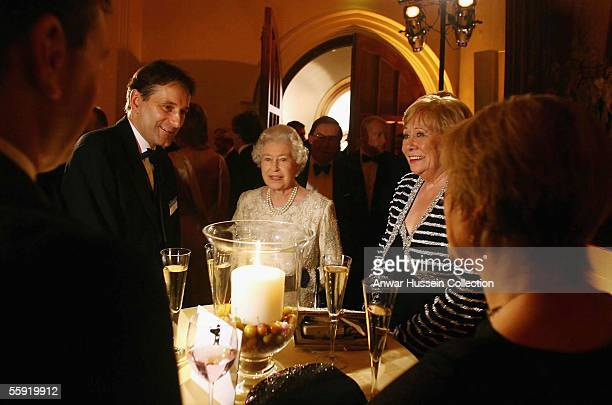 Britain's Queen Elizabeth II chats to guests including Liz Dawn who plays Vera Duckworth in Coronation Street at the ITV 50th Anniversary celebration...
