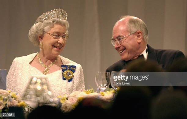 Britains Queen Elizabeth II chats with Prime Minister of Australia John Howard at a dinner at Festival Centre February 27 2002 in Adelaide Australia...