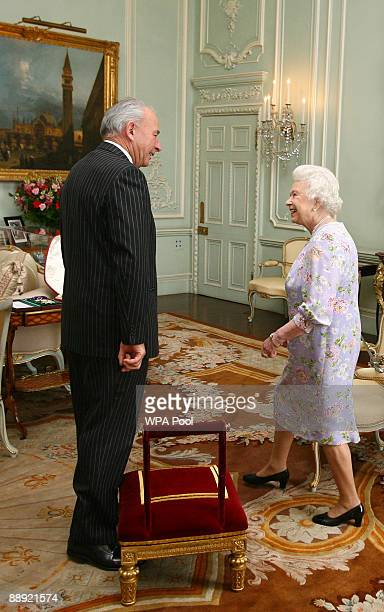 Britain's Queen Elizabeth II confers the honour of Knighthood to Sir Donald McKinnon inside Buckingham Palace in on July 9 2009 in London United...