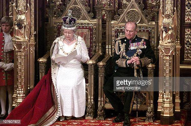 Britain's Queen Elizabeth II delivers a speech 06 December 2000 during the state opening of Parliament in the House of Lords in London as her husband...