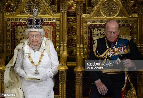 Britain's Queen Elizabeth II delivers the Queen's Speech from the Throne in the House of Lords next to Prince Philip Duke of Edinburgh during the...