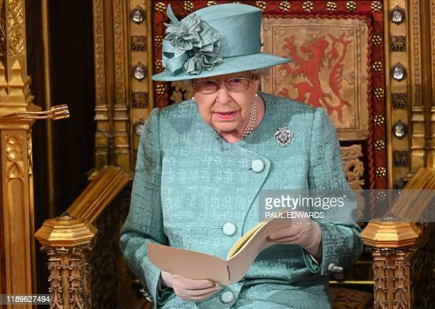 Britain's Queen Elizabeth II delivers the Queen's Speech on the The Sovereign's Throne in the House of Lords chamber during the State Opening of...