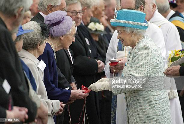 Britain's Queen Elizabeth II distributes the Maundy money during the Royal Maundy Service at York Minster in York northern England April 5 2012...