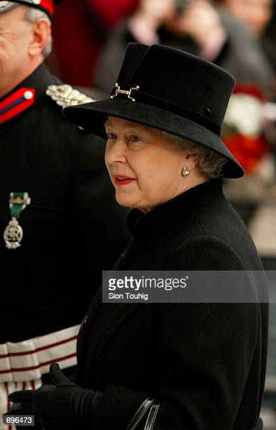 Britains Queen Elizabeth II dressed in official mourning attire arrives at the Salvation Armys Booth House February 12 2002 in London The visit was...