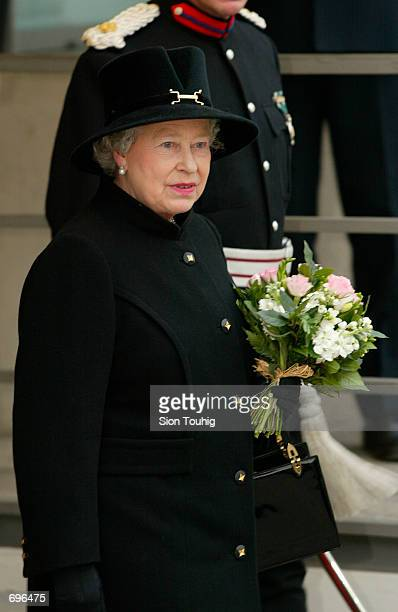 Britains Queen Elizabeth II dressed in official mourning attire leaves the Salvation Armys Booth House February 12 2002 in London The visit was her...