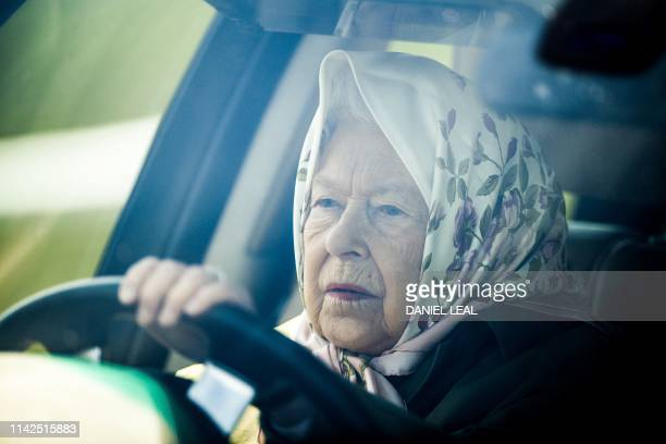 TOPSHOT Britain's Queen Elizabeth II drives her Range Rover car as she arrives to attend the annual Royal Windsor Horse Show in Windsor west of...