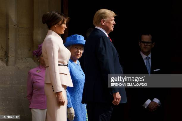 Britain's Queen Elizabeth II escorts US President Donald Trump and US First Lady Melania Trump into Windsor Castle in Windsor west of London on July...