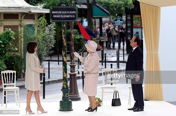 Britain's Queen Elizabeth II, French President Francois Hollande and Paris Mayor Anne Hidalgo, unveil a plaque during during a ceremony for the...