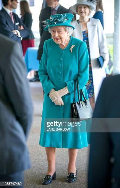 Britain's Queen Elizabeth II gestures during a visit to the Edinburgh Climate Change Institute at the University of Edinburgh in Edinburgh, Scotland...