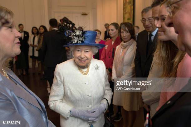 Britain's Queen Elizabeth II gestures during her visit to Canada House in London on July 19 to mark the 150th anniversary of Confederation / AFP...
