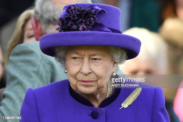Britain's Queen Elizabeth II gestures on her arrival at the annual Braemar Gathering in Braemar central Scotland on September 7 2019 The Braemar...