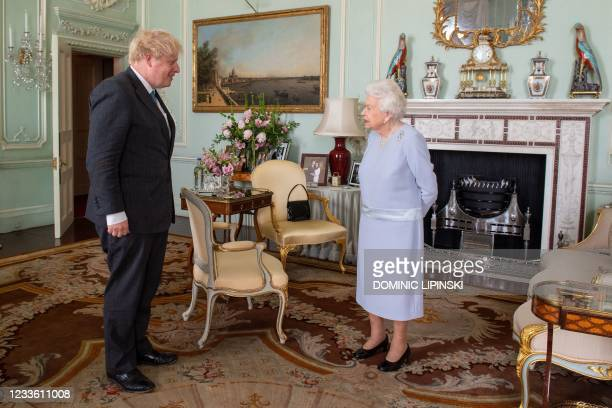 Britain's Queen Elizabeth II greets Britain's Prime Minister Boris Johnson during an audience at Buckingham Palace in central London on June 23 the...