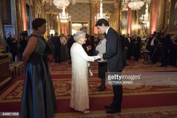 Britain's Queen Elizabeth II greets Canada's Prime Minister Justin Trudeau in the Blue Drawing Room during a drinks reception before The Queen's...