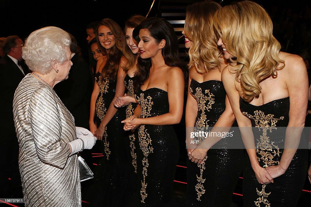 Britain's Queen Elizabeth II (L) greets Cheryl Cole (C) from British-Irish pop band Girls Aloud after the Royal Variety Performance at the Royal Albert Hall in London on November 19, 2012. The Queen, accompanied by The Duke of Edinburgh, attended the Royal Variety Performance in the show's 100th anniversary year where she met with stars of the show including Kylie Minogue, tenor Andrea Bocelli and the performing dog Pudsey.