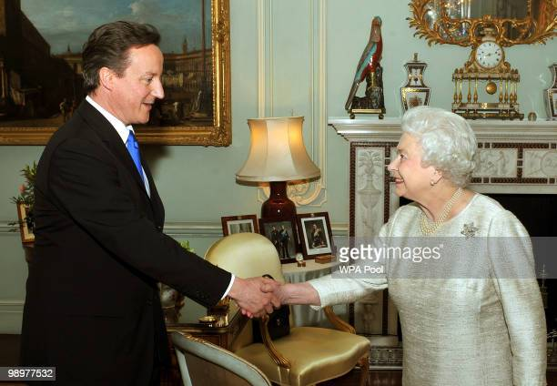 Britain's Queen Elizabeth II greets David Cameron at Buckingham Palace in an audience to invite him to be the next Prime Minister, on May 11, 2010 in...