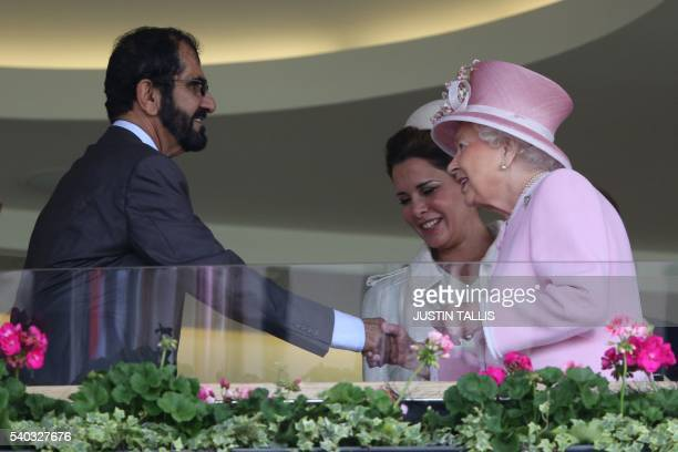 Britain's Queen Elizabeth II greets Emir of Dubai Sheikh Mohammed bin Rashid alMaktoum and Jordan's Princess Haya bint alHussein in the Royal Box on...