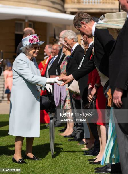 Britain's Queen Elizabeth II greets guests at the Garden Party at Buckingham Palace in central London on May 21 2019