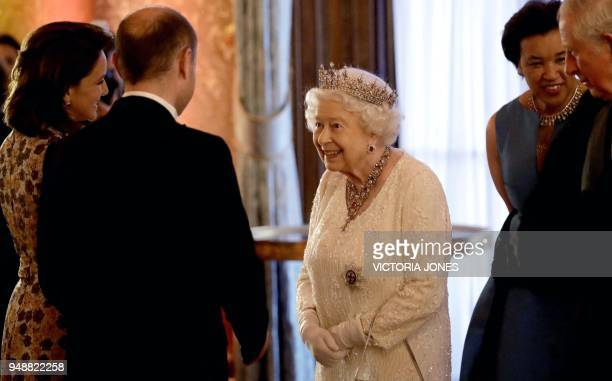 Britain's Queen Elizabeth II greets Malta's Prime Minister Joseph Muscat and and his wife Michelle in the Blue Drawing Room during a drinks reception...