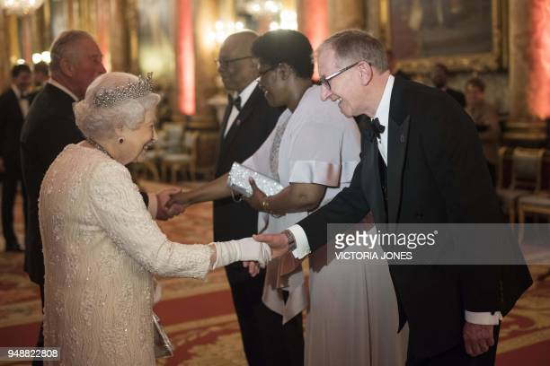 Britain's Queen Elizabeth II greets Philip May husband of Britain's Prime Minister Theresa May before The Queen's Dinner during The Commonwealth...
